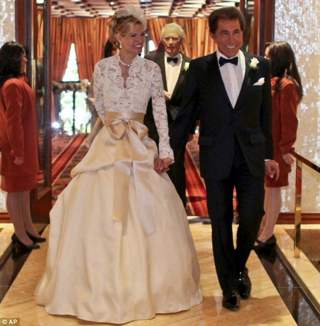 The Duke and Duchess of Vegas: Wynn and his bride Andrea Hissom, at their wedding ceremony at the billionaire's Encore casino on Saturday. Actor Clint Eastwood - said to be the groom's Best Man can just be seen in the background of the picture