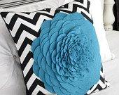 Black chevron with Peacock blue felt flower. 18x18