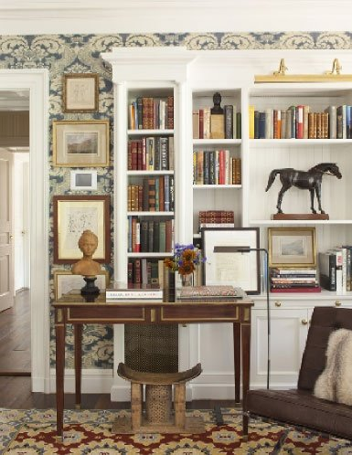 "The art of bookcase styling - David Netto design - The ""centerpiece"" leather racehorse was found in London. Photo Johnathan Wallen."