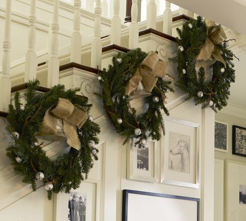 wreaths hanging at the bottom of the rail