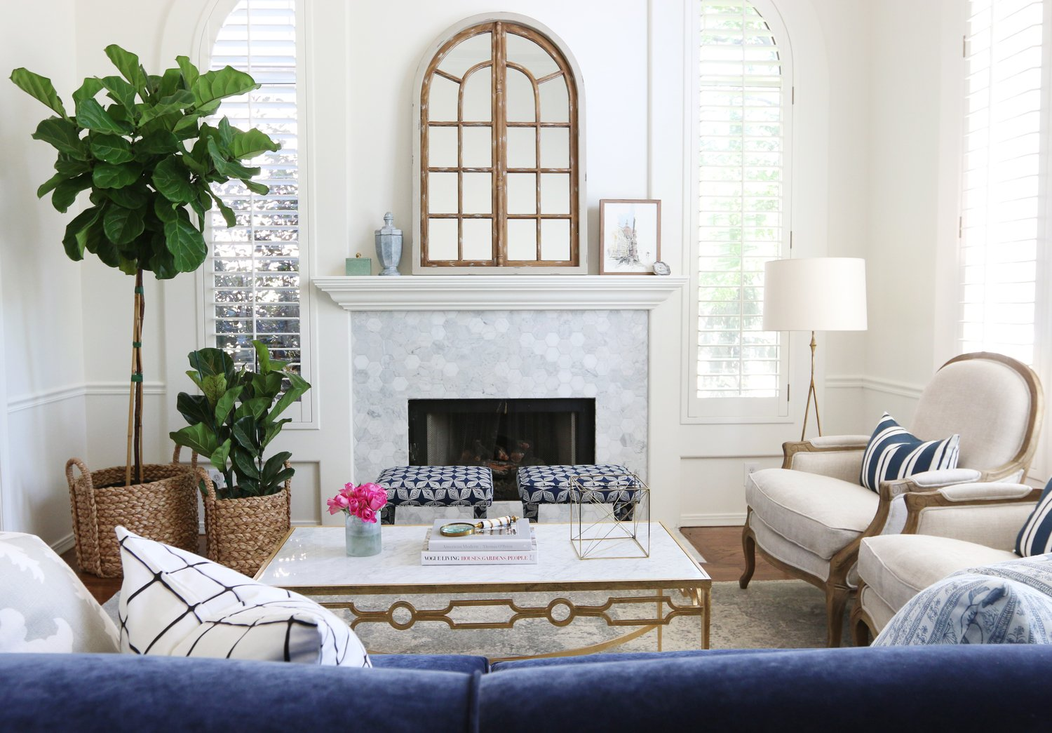 Friday eye candy designers to watch a thoughtful place for Navy blue white and gold living room